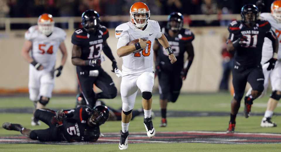 Oklahoma State 's Clint Chelf (10) runs for a 67 yard touchdown during the college football game between the Oklahoma State University Cowboys (OSU) and the Texas Tech University Red Raiders (TTU) at Jones AT&T Stadium in Lubbock, Tex. on Saturday, Nov. 2, 2013.  Photo by Chris Landsberger, The Oklahoman