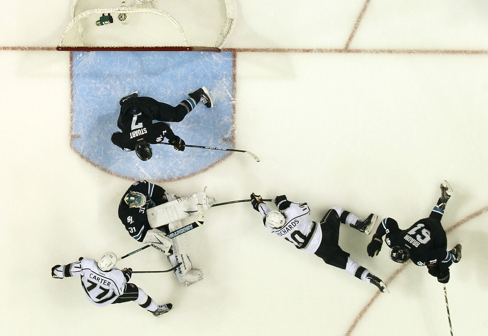 Photo - San Jose Sharks goalie Antti Niemi (31), of Finland, blocks a goal attempt against Los Angeles Kings center Mike Richards (10) as San Jose Sharks defenseman Justin Braun (61) and San Jose Sharks defenseman Brad Stuart (7) defends during the second period in Game 3 of their second-round NHL hockey Stanley Cup playoff series, Saturday, May 18, 2013, in San Jose, Calif. (AP Photo/Tony Avelar)