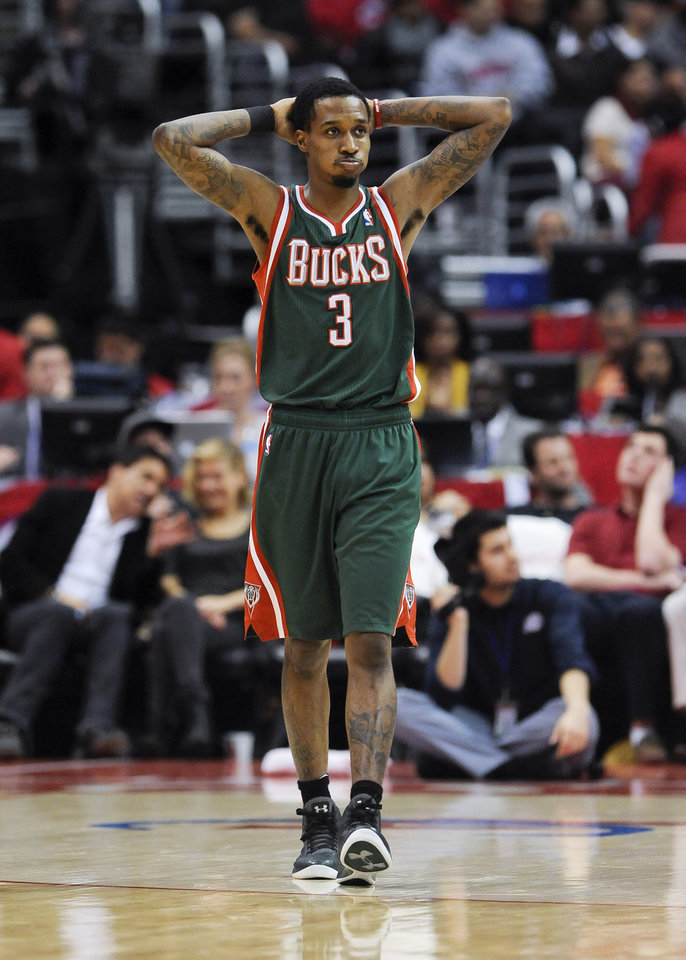 Photo - Milwaukee Bucks guard Brandon Jennings reacts to a foul in the first half of an NBA basketball game against Los Angeles Clippers, Wednesday, March 6, 2013, in Los Angeles.(AP Photo/Gus Ruelas)