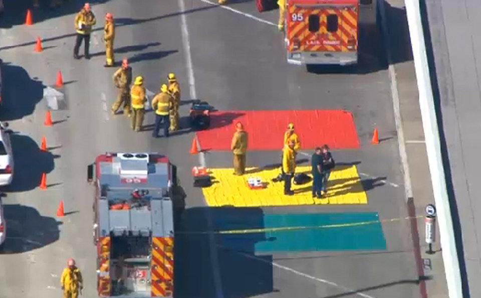 Photo - In this aerial video frame grab provided by CBS-LA, fire and rescue personnel gather at Los Angeles International Airport on Friday Nov. 1, 2013. Shots were fired Friday at Los Angeles International Airport, prompting authorities to evacuate a terminal and stop flights headed for the city from taking off from other airports. (AP Photo/CBS-LA)