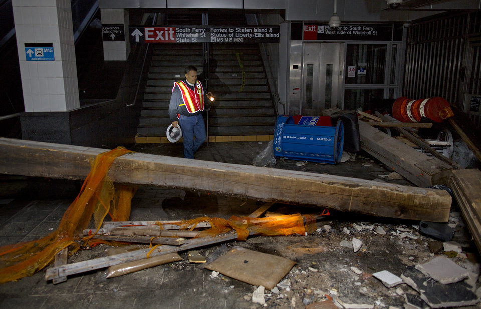 Joseph Leader, Metropolitan Transportation Authority Vice President and Chief Maintenance Officer, walks around massive fallen beams and other debris in the South Ferry 1 train station Wednesday, Oct. 31, 2012, in New York. Huge amounts of debris and as much as 20 feet of water fills the station and tunnel in the wake of superstorm Sandy. (AP Photo/Craig Ruttle) ORG XMIT: NYCR119