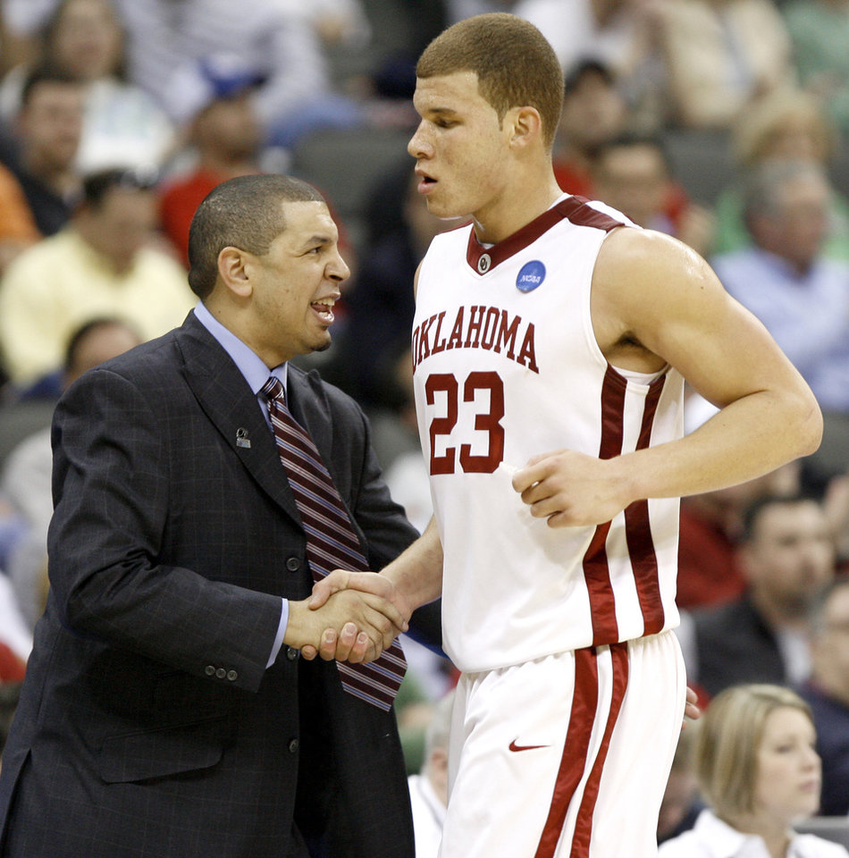 Photo - OU coach Jeff Capel greets Balke Griffin as he comes off the court during a first round game of the men's NCAA tournament between Oklahoma and Morgan State in Kansas City, Mo., Thursday, March 19, 2009.  PHOTO BY BRYAN TERRY, THE OKLAHOMAN