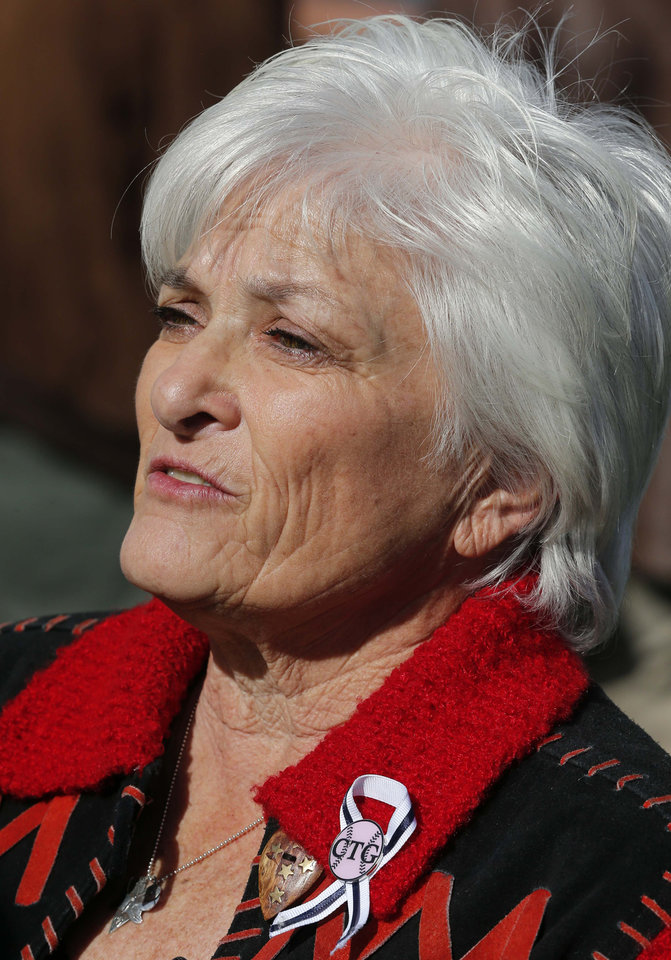 Photo - Patricia Maisch, who helped stop the Tucson shooter, attends the remembrance ceremony on the third anniversary of the Tucson shootings, Wednesday, Jan. 8, 2014, in Tucson, Ariz. Six people were killed and 13 wounded, including U.S. Rep. Gabrielle Giffords, D-Ariz., in the shooting rampage at a community event hosted by Giffords in 2011. Jared Lee Loughner was sentenced in November 2012 to seven consecutive life sentences, plus 140 years, after he pleaded guilty to 19 federal charges in the shooting. (AP Photo/Matt York)
