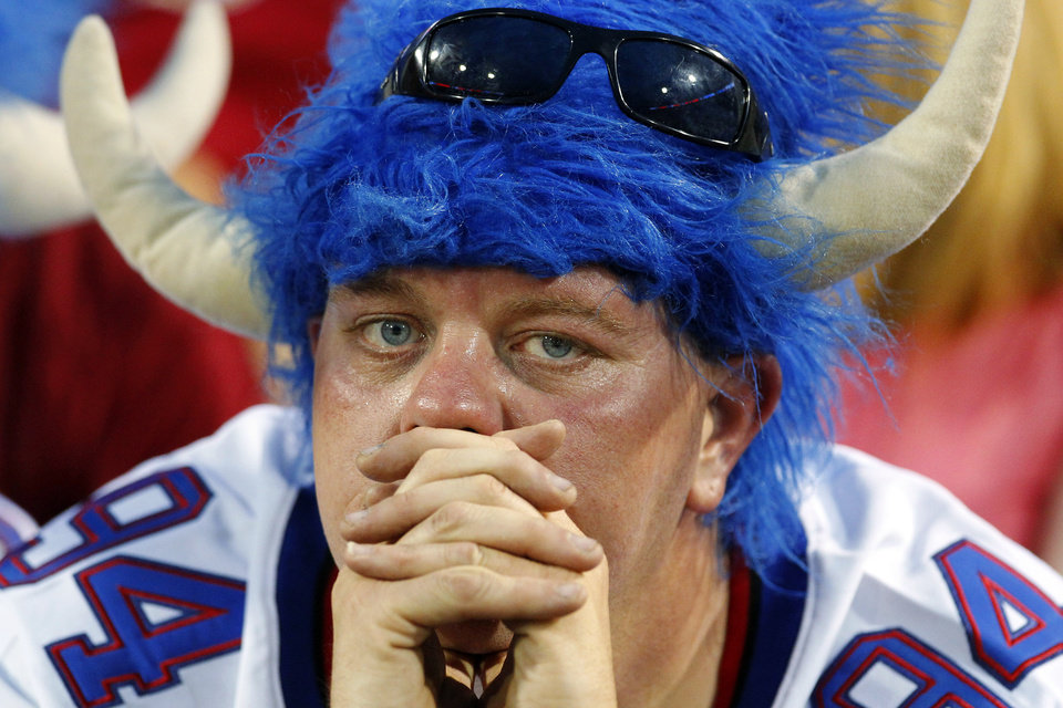 Photo -   A Buffalo Bills fan wearing a replica Mario Williams (94) jersey watches during the first half of a preseason NFL football game against the Washington Redskins in Orchard Park, N.Y., Thursday, Aug. 9, 2012. The Redskins won 7-6. (AP Photo/Bill Wippert)