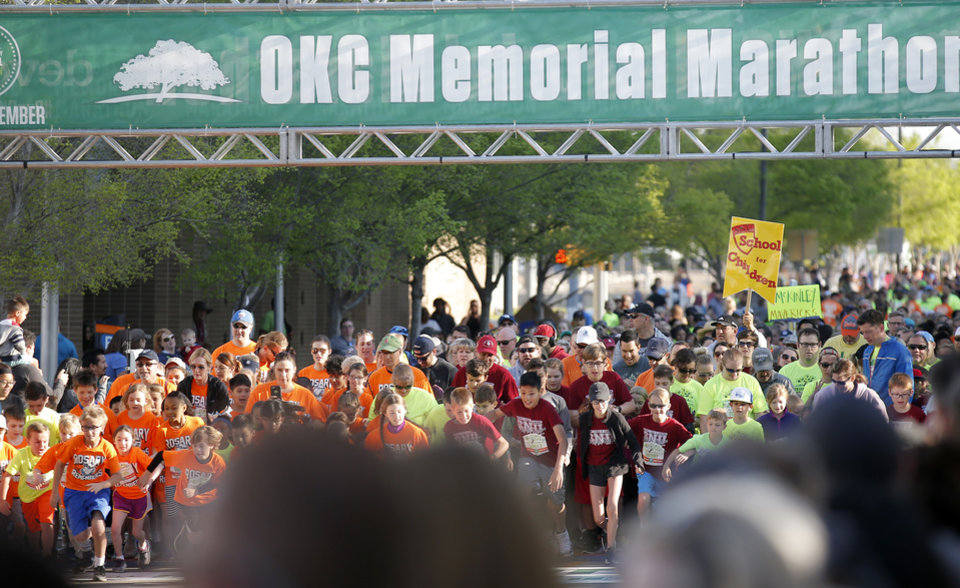 Photo - Children race in the kids marathon during the Oklahoma City Marathon in Oklahoma City,  Sunday, April 29, 2018. Photo by Sarah Phipps, The Oklahoman
