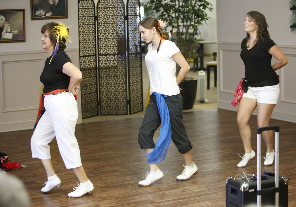 Barbara Caballero (left), Rebecca Davidson, and Hillary Dagg, with the Cottonwood Creek Cloggers, perform for residents at Fountain Brook Assisted Living in Midwest City, OK, Thursday, July 19, 2012,  By Paul Hellstern, The Oklahoman