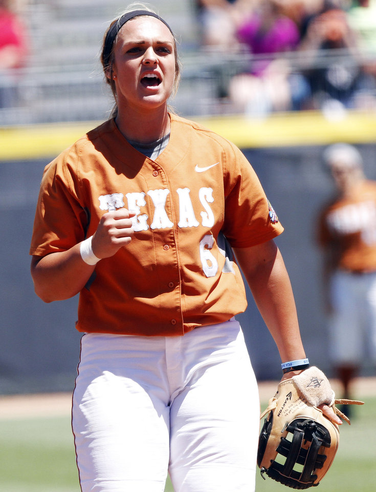 Photo - Texas third baseman Taylor Hoagland celebrates after pitcher Blaire Luna strikes a batter out in the Women's College World Series elimination game versus Florida. The Longhorns would go on to win 3-0. Photo by KT KING, The Oklahoman