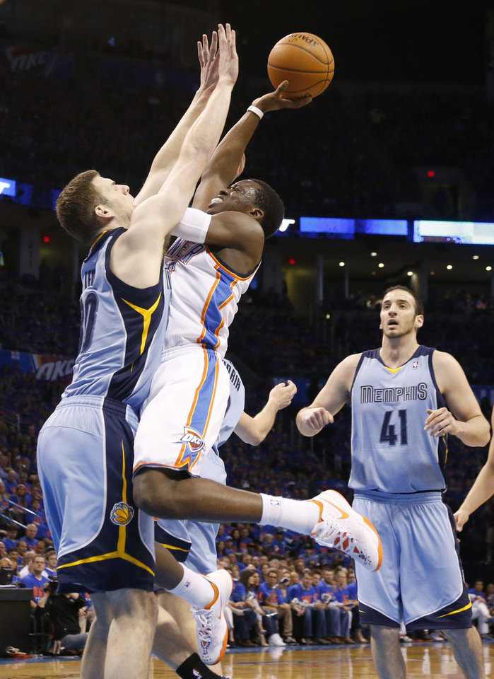 Photo - Oklahoma City's Reggie Jackson (15) shoots over Memphis' Jon Leuer (30)  during Game 7 in the first round of the NBA playoffs between the Oklahoma City Thunder and the Memphis Grizzlies at Chesapeake Energy Arena in Oklahoma City, Saturday, May 3, 2014. Photo by Nate Billings, The Oklahoman
