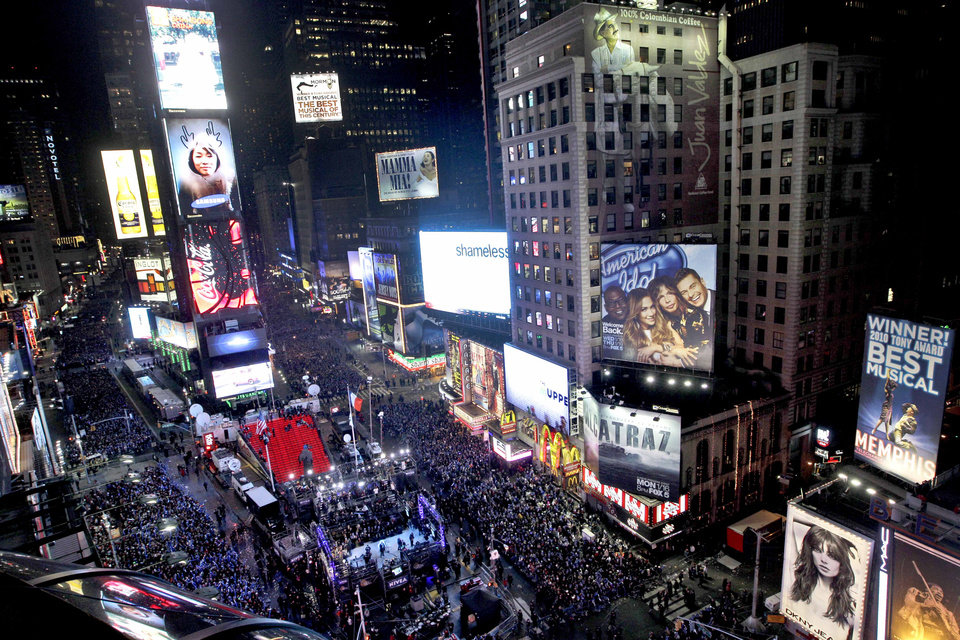"FILE - In this Dec. 31, 2011 file photo, the crowd packs New York's Times Square during the New Year's Eve celebration as seen from the Marriott Marquis hotel. It�s no small task making sure the annual celebration remains safe, but the New York City police use an array of security measures for the event that turns the ""Crossroads of the World"" into a massive street party in the heart of Manhattan. (AP Photo/Mary Altaffer, File)"