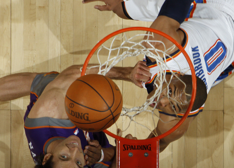 Photo - Oklahoma City's Russell Westbrook (0)and Phoenix's Steve Nash position for a rebound during the NBA basketball game between the Oklahoma City Thunder and the Phoenix Suns, Sunday, Dec. 19, 2010, at the Oklahoma City Arena. Photo by Sarah Phipps, The Oklahoman