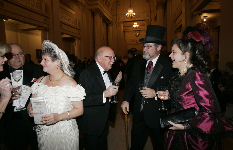Photo - Linda Northup, left in a white hat, and her husband Dale Northup, center of Guthrie, enjoy themselves as Dale talks to Rick and Stacy Staton, of Guthrie, right, at the Oklahoma Centennial Statehood Inaugural Ball, Saturday, Nov. 17, 2007, at the Guthrie Scottish Rite Masonic Center, in Guthrie, Okla. By Bill Waugh, The Oklahoman