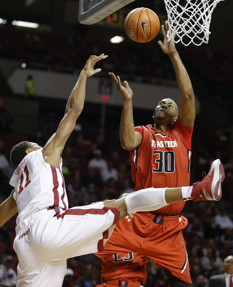 Photo - Texas Tech's Jaye Crockett (30) blocks the shot of Oklahoma's Isaiah Cousins (11) during an NCAA college basketball game between the University of Oklahoma and Texas Tech University at the Lloyd Noble Center in Norman, Okla., Wednesday, Feb. 12, 2014. Photo by Bryan Terry, The Oklahoman