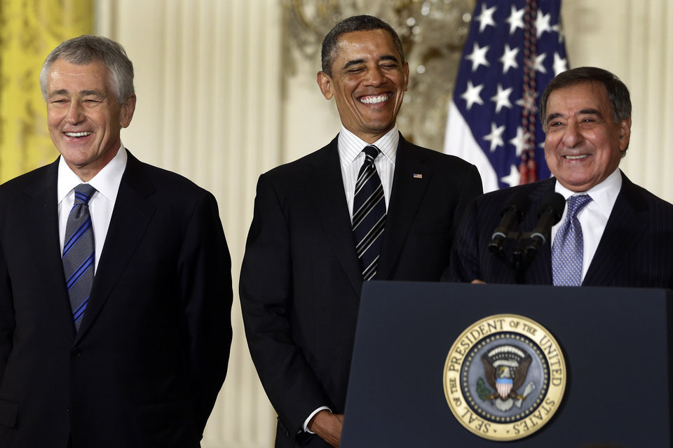 In this Jan. 7, 2013, file photo, President Barack Obama and his choice for Defense Secretary, former Nebraska Sen. Chuck Hagel, left, laugh as current Defense Secretary Leon Panetta speaks in the East Room of the White House in Washington, Monday, Jan. 7, 2013, where the president announced his nomination of Hagel. In 1989, former President Richard Nixon said unless a nominee is clearly unqualified, the Senate should respect the right of a president to fill his Cabinet. Nixon�s words came during the bitter fight over President George H.W. Bush�s choice of John Tower for the Pentagon post. The Democratic-led Senate rejected him. Now, Obama�s choice of Hagel to be defense secretary will be a test for Senate Republicans, including those who fought strenuously for Tower. (AP Photo/Charles Dharapak, file)