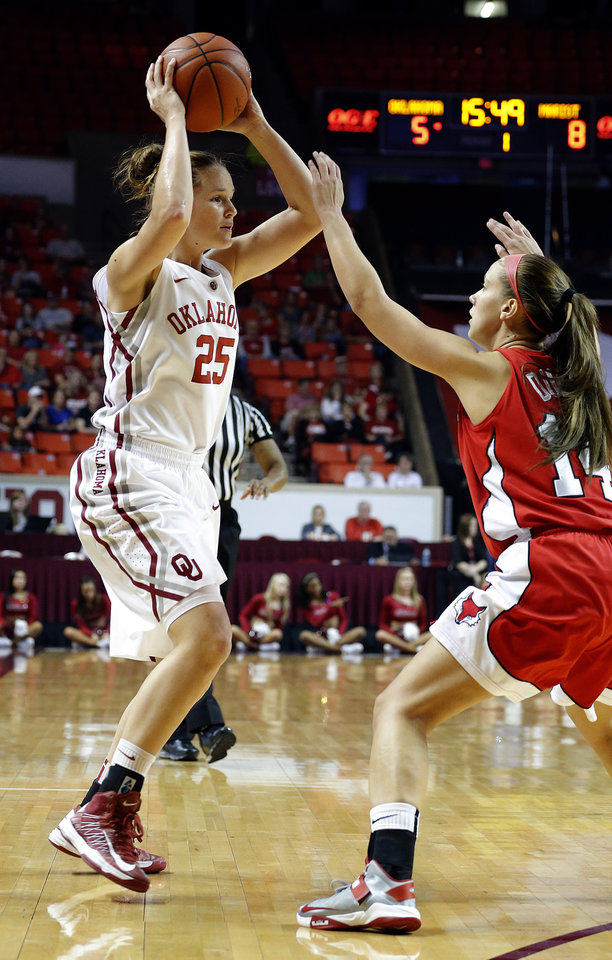 Photo - Oklahoma's Whitney Hand (25) loosk to pass the ball as Marist's Leanne Ockenden (11) defends during the women's college basketball game between the University of Oklahoma and Marist at Lloyd Noble Center in Norman, Okla.,  Sunday,Dec. 2, 2012. Photo by Sarah Phipps, The Oklahoman
