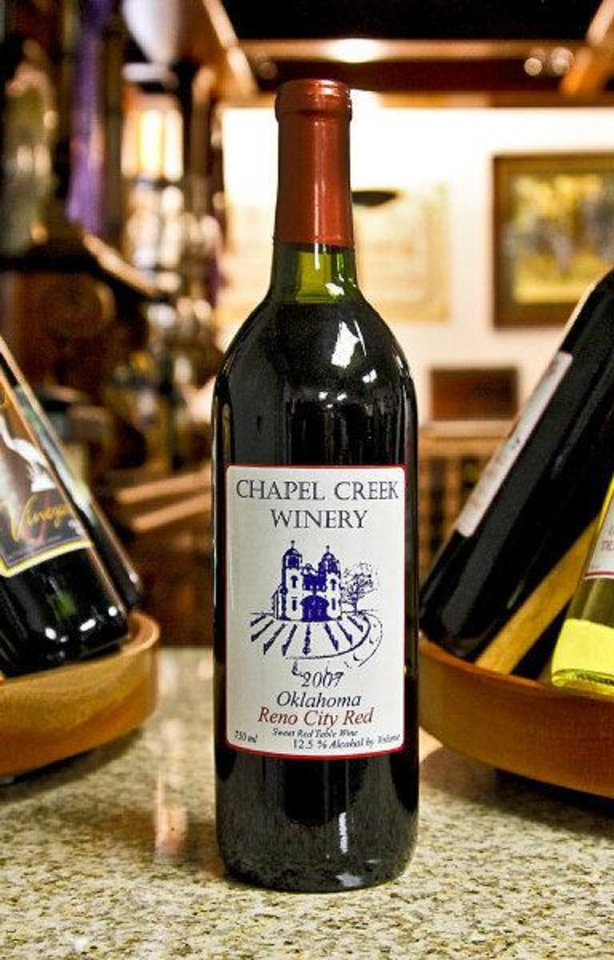 Photo - A bottle of red wine created at Chapel Creek Winery in El Reno. Photo by Chris Landsberger, The Oklahoman  CHRIS LANDSBERGER