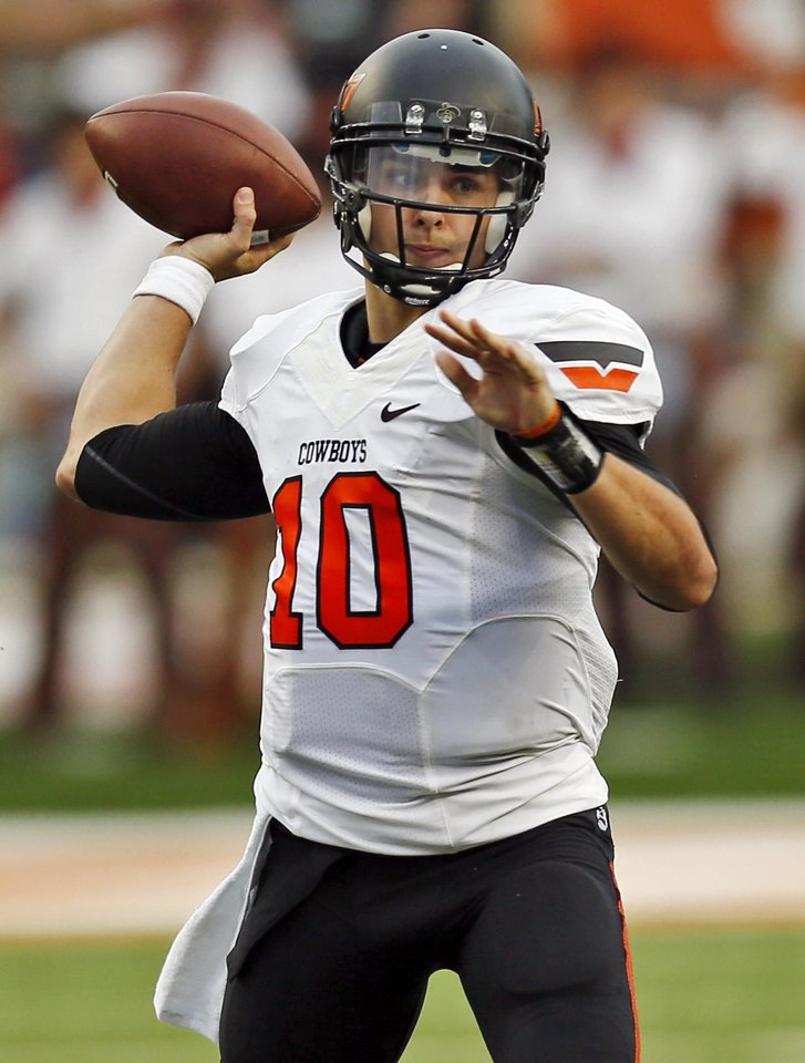Oklahoma State's Clint Chelf (10) passes during a college football game between the Oklahoma State University Cowboys (OSU) and the University of Texas Longhorns (UT) at Darrell K Royal - Texas Memorial Stadium in Austin, Texas, Saturday, Nov. 16, 2013. OSU won, 38-13. Photo by Nate Billings, The Oklahoman