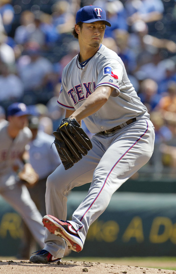 Photo -   Texas Rangers starting pitcher Yu Darvish faces a Kansas City Royals batter during the first inning of a baseball game at Kauffman Stadium in Kansas City, Mo., Monday, Sept. 3, 2012. (AP Photo/Orlin Wagner)