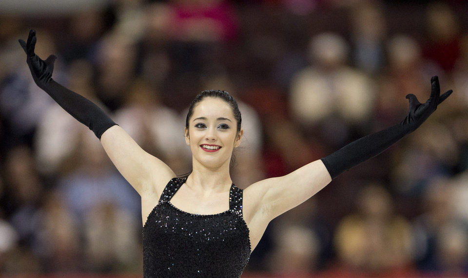 Photo - Kaetlyn Osmond performs her short program  during women's competition at the Canadian figure skating championships Friday Jan. 10, 2014 in Ottawa. (AP Photo/The Canadian Press, Adrian Wyld)