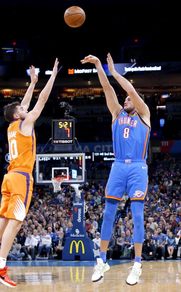 Photo - Oklahoma City's Danilo Gallinari (8) shoots as Phoenix's Ty Jerome (10) defends during the NBA basketball game between the Oklahoma City Thunder and the Phoenix Suns at the Chesapeake Energy Arena in Oklahoma City , Friday, Dec. 20, 2019.   [Sarah Phipps/The Oklahoman]