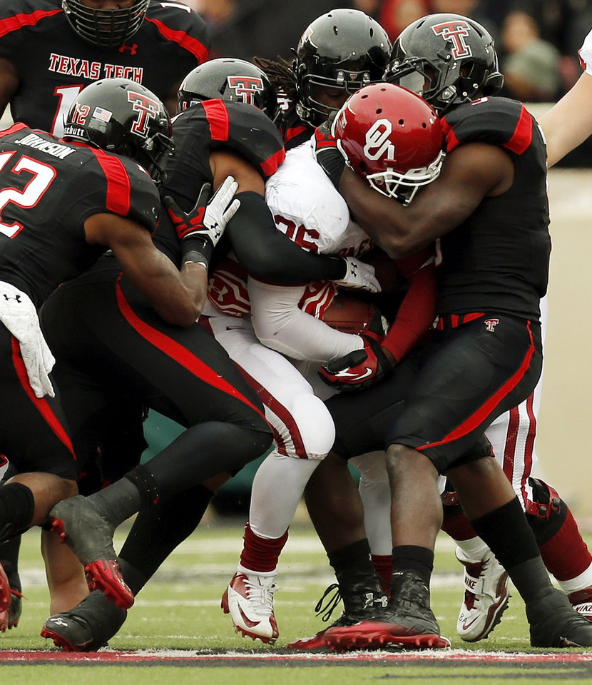 A gang of Texas Tech defenders stop Oklahoma's Damien Williams (26) during a college football game between the University of Oklahoma (OU) and Texas Tech University at Jones AT&T Stadium in Lubbock, Texas, Saturday, Oct. 6, 2012. OU won, 41-20. Photo by Nate Billings, The Oklahoman