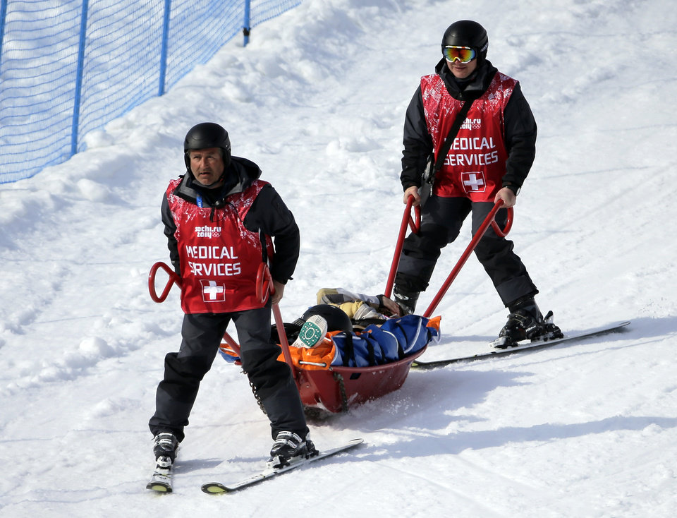 Photo - Jacqueline Hernandez of the United States is carried in a stretcher after crashing in a seeding run during women's snowboard cross competition at the Rosa Khutor Extreme Park, at the 2014 Winter Olympics, Sunday, Feb. 16, 2014, in Krasnaya Polyana, Russia. (AP Photo/Andy Wong)