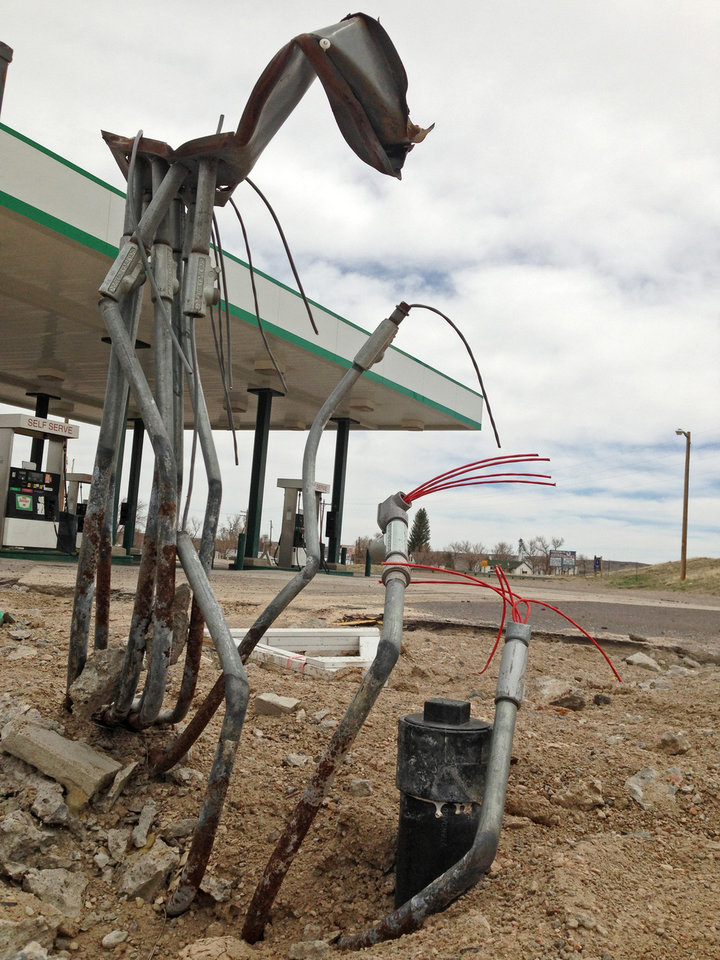This April 29,2013 photo shows all that remained of the Horton's Corner convenience store, foreground, in Chugwater, Wyo., after a Dec. 30, 2012 fire caused by a sport utility vehicle that crashed into the store. Horton's Corner was the only place for miles around to get gas or groceries and may not be rebuilt for several months yet. (AP Photo/Mead Gruver)