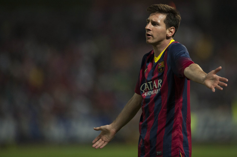 Photo - Barcelona's Lionel Messi from Argentina gestures during a Spanish La Liga soccer match between FC Granada and FC Barcelona at Los Carmenes stadium in Granada, Spain, Saturday, April 12, 2014. (AP Photo/Daniel Tejedor)