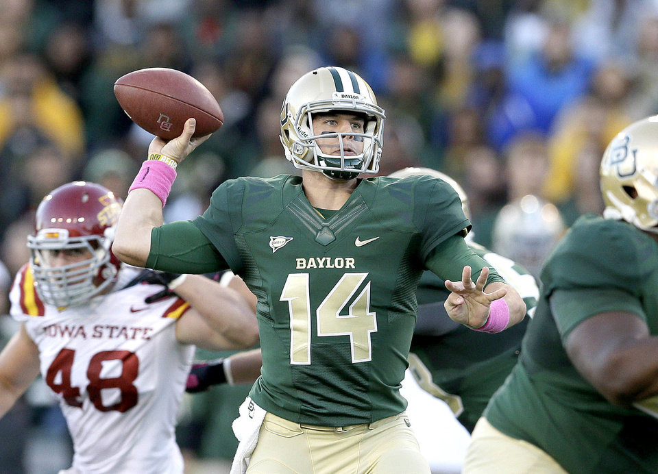 Photo - Baylor quarterback Bryce Petty threw for 343 yards and two touchdowns against Iowa State on Saturday night. AP photo