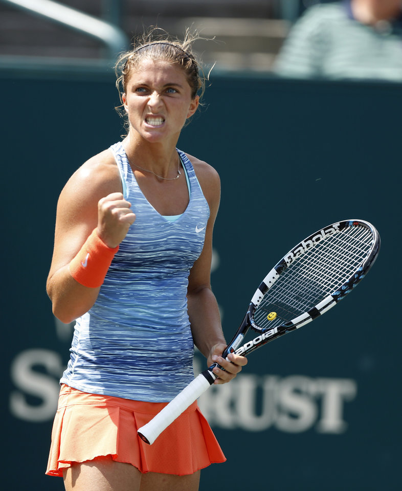 Photo - Sara Errani, of Italy, reacts to Peng Shuai, of China, during the Family Circle Cup tennis tournament in Charleston, S.C., Thursday, April 3, 2014. (AP Photo/Mic Smith)