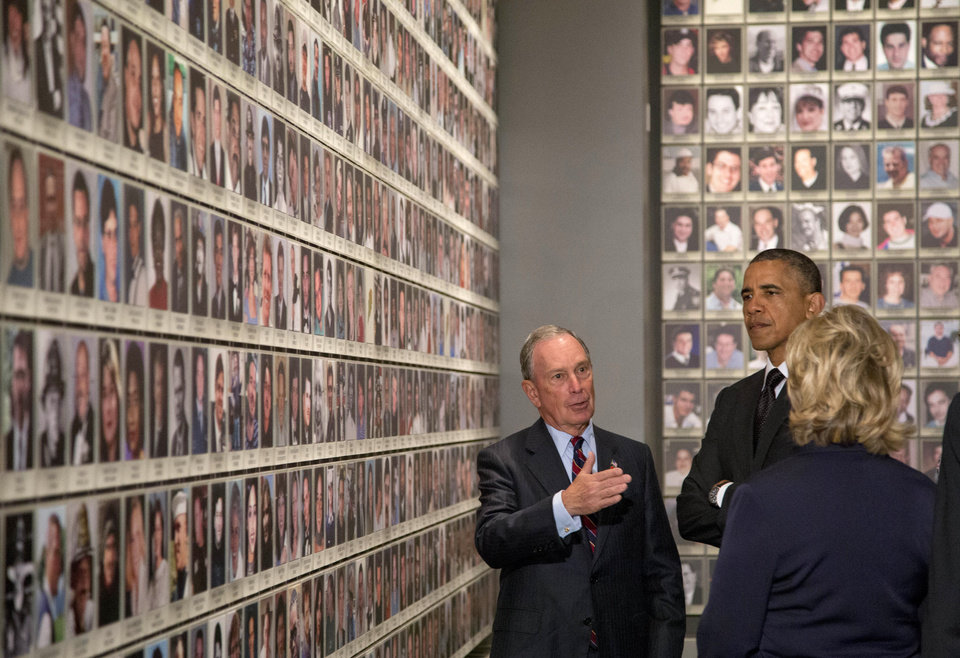 Photo - President Barack Obama and former Secretary of State Hillary Rodham Clinton tour  Memorial Hall at the National September 11 Memorial Museum with former New York City Mayor Michael Bloomberg, Thursday, May 15, 2014, in New York. Speaking at the dedication, the president said, no act of terror can match the strength and character of the United States.   (AP Photo/Carolyn Kaster)