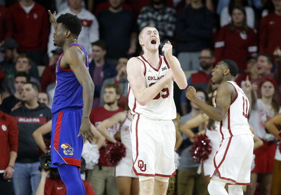 Photo - Oklahoma's Brady Manek (35) and De'Vion Harmon (11) react beide Kansas' Udoka Azubuike (35) during an NCAA college basketball game between the University of Oklahoma Sooners (OU) and the University of Kansas Jayhawks at Lloyd Noble Center in Norman, Okla., Tuesday, Jan. 14, 2020. Oklahoma lost 66-52.  [Bryan Terry/The Oklahoman]