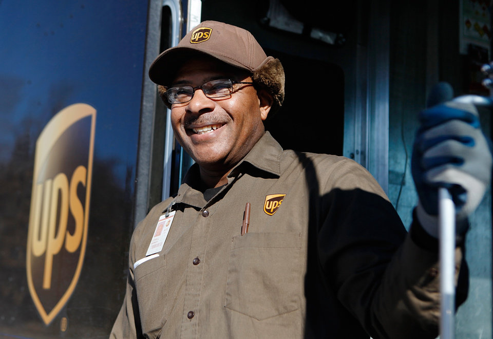 Photo - WINTER STORM / SNOWSTORM / BLIZZARD AFTERMATH / ICE / SNOW / DIGGING OUT: UPS driver Lowell Harkey in Edmond on Monday, Dec. 28, 2009. People are still digging out from Christmas Eve snowfall.   Photo by Jim Beckel, The Oklahoman ORG XMIT: KOD