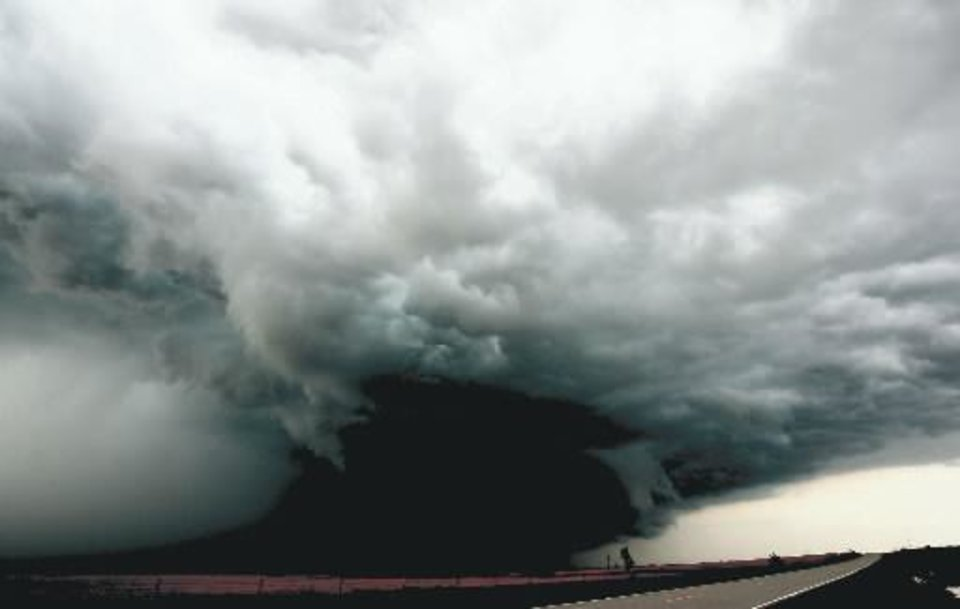 Photo - File photo - A large wall cloud forms over Marshall, Okla., Saturday, May 24, 2008. The wall cloud was responsible for several tornadoes in the area. BY SARAH PHIPPS