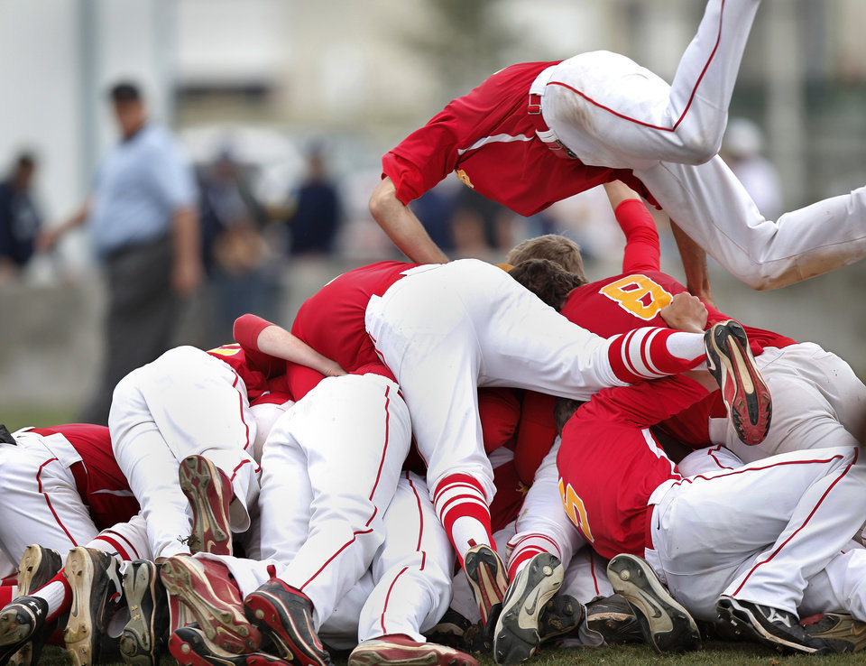 Photo - Dale players celebrate their championship win by forming a human pile on the pitcher's mound after pitcher Evan Anderson struck out the last batter to end  the Class 2A state high school baseball championship game  at Shawnee High School's Memorial Park. on Saturday,,  May 12, 2012.  Dale shut-out the Silo Rebels, 11-0 after 6 innings.       Photo by Jim Beckel, The Oklahoman