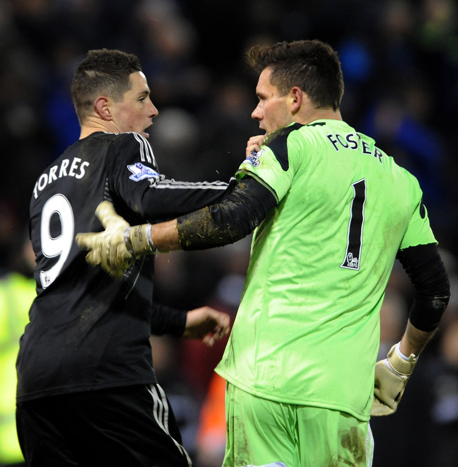 Photo - West Brom's goalkeeper Ben Foster right, reacts with Chelsea's Fernando Torres after the English Premier League soccer match between West Bromwich Albion and Chelsea at The Hawthorns Stadium in West Bromwich, England, Tuesday, Feb. 11, 2014.  (AP Photo/Rui Vieira)