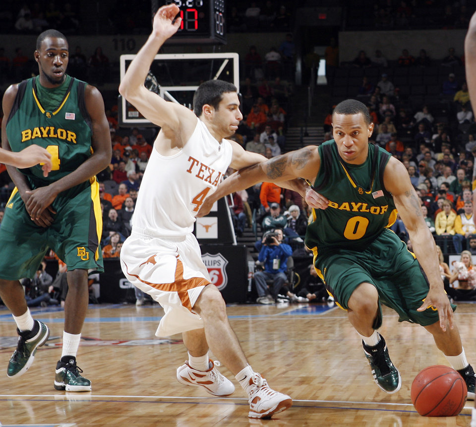 Photo - BIG 12 TOURNAMENT / COLLEGE BASKETBALL: Baylor's Curtis Jerrells (0) drives past Texas' Dogus Balbay (4) in the semifinal game of the Big 12 Men's Basketball Championships between The University of Baylor and The University of Texas at the Ford Center on Friday, March 13, 2009, in Oklahoma City, Okla.  PHOTO BY CHRIS LANDSBERGER, THE OKLAHOMAN  ORG XMIT: KOD
