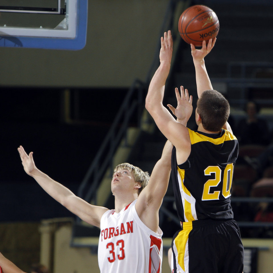 Photo - Arnett's Tyler Tune shoots over Forgan's Tanner Jones during the Class B boys state championship high school basketball game  at the State Fair Arena in Oklahoma City,  Saturday, March 3, 2012. Photo by Sarah Phipps, The Oklahoman