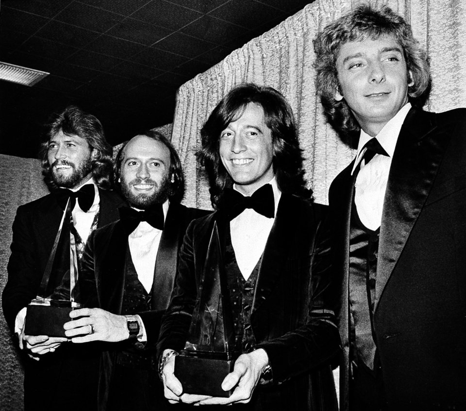 Photo -   In this Friday, Jan. 13, 1979 file photo, members of the Bee Gees pose with Barry Manilow, far right, at the American Music Awards in Los Angeles, Ca. The brothers Gibb, from left, Barry, Maurice, and Robin, won awards for favorite popular group and favorite soul album for