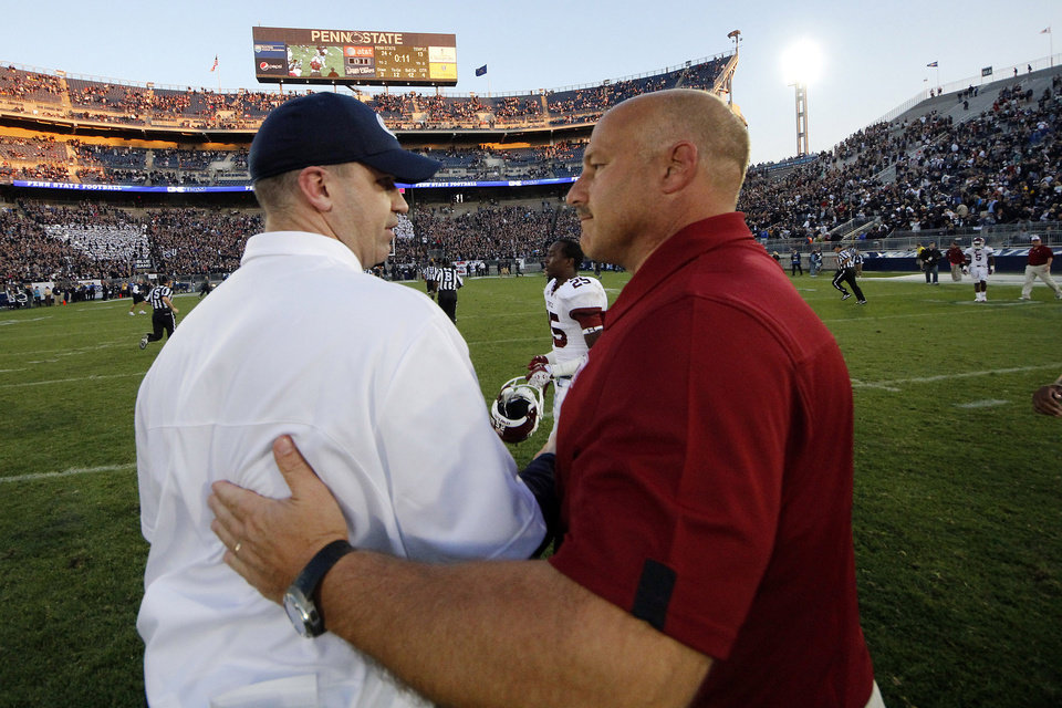 Photo -   Penn State head coach Bill O'Brien, left, shakes hands with Temple head coach Steve Addazio after an NCAA college football game in State College, Pa., Saturday, Sept. 22, 2012. Penn State won 24-13. (AP Photo/Gene J. Puskar)
