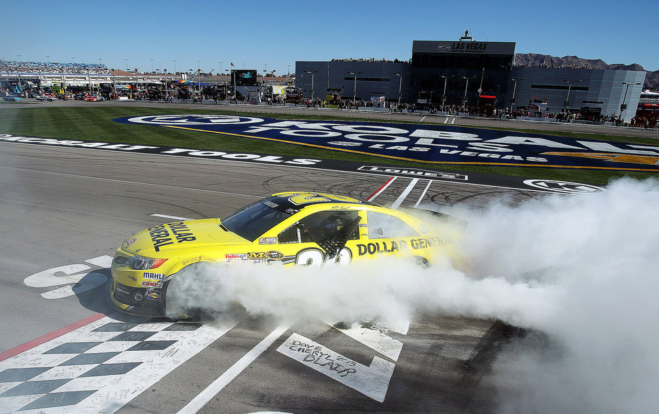 Driver Matt Kenseth burns out after winning the NASCAR Sprint Cup Series auto race on Sunday, March 10, 2013, in Las Vegas. (AP Photo/Isaac Brekken)