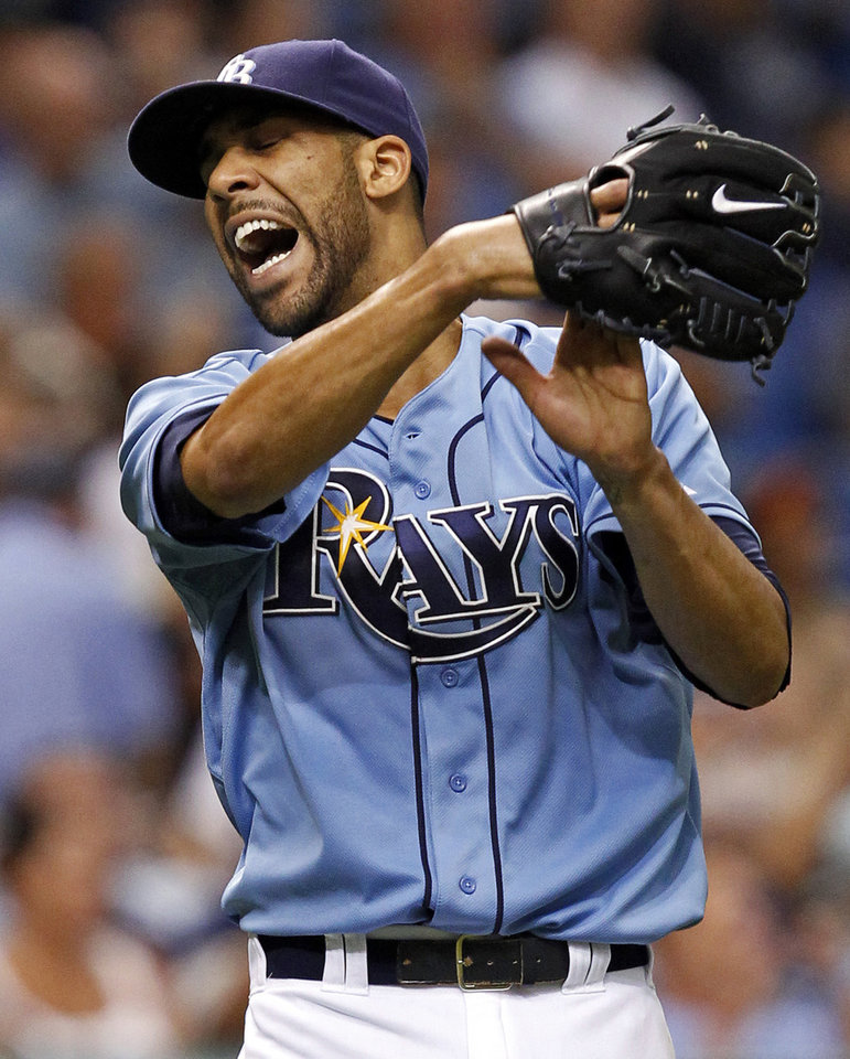 Photo -   FILE - This Aug. 5, 2012 file photo shows Tampa Bay Rays' David Price reacting to a catch by right fielder Matt Joyce on a fly ball by Baltimore Orioles' Taylor Teagarden during the second inning of a baseball game in St. Petersburg, Fla. Price and 2011 winner Justin Verlander are among the finalists for this year's AL Cy Young Award, Wednesday, Nov. 14, 2012. (AP Photo/Mike Carlson, FIle)