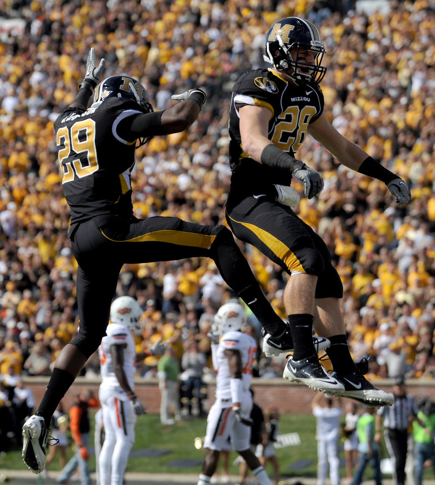 Missouri's Jerrell Jackson, left, congratulates teammate T.J. Moe on his 34-yard touchdown catch during the first half of an NCAA college football game against Oklahoma State Saturday, Oct. 22, 2011, in Columbia, Mo. (AP Photo/L.G. Patterson)