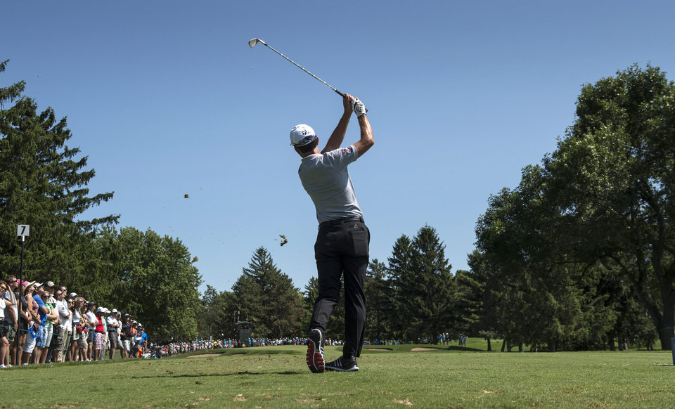 Photo - Mike Weir hits off the seventh tee during first-round play at the Canadian Open golf championship on Thursday, July 24, 2014, in Montreal. (AP Photo/The Canadian Press, Paul Chiasson)