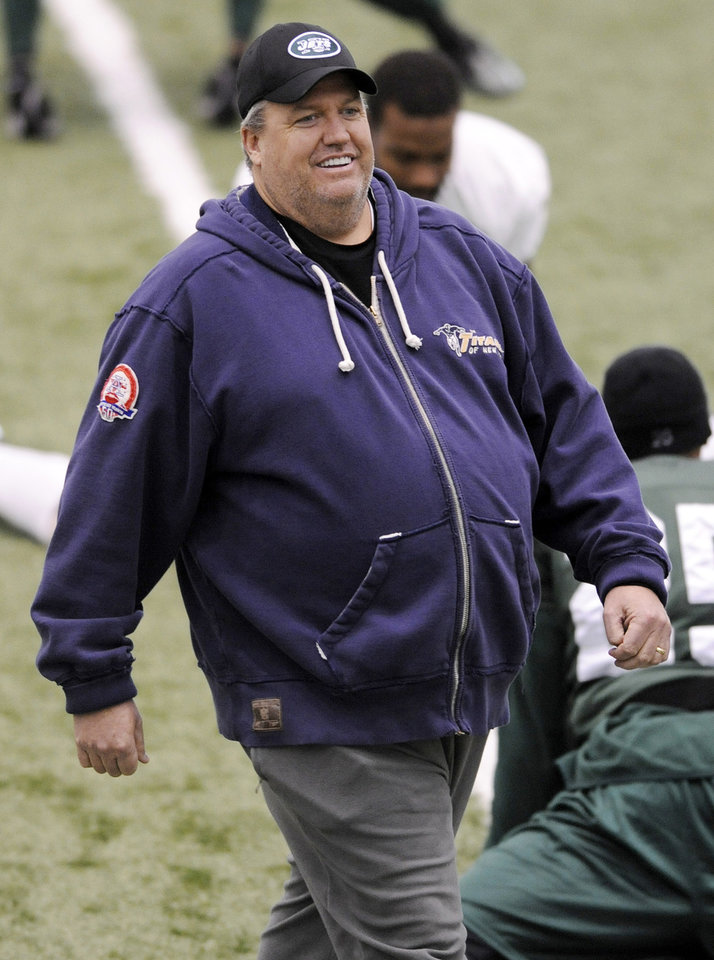 Photo - New York Jets coach Rex Ryan watches players stretch during football practice, Wednesday, Jan. 13, 2010, in Florham Park, N.J. The Jets play the San Diego Chargers in an NFL football divisional playoff game on Sunday, Jan. 17 in San Diego. (AP Photo/Bill Kostroun) ORG XMIT: NJBK103
