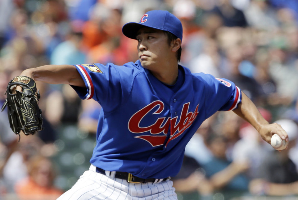 Photo - Chicago Cubs starter Tsuyoshi Wada, of Japan, throws against the Baltimore Orioles during the first inning of an interleague baseball game in Chicago, Sunday, Aug. 24, 2014. (AP Photo/Nam Y. Huh)