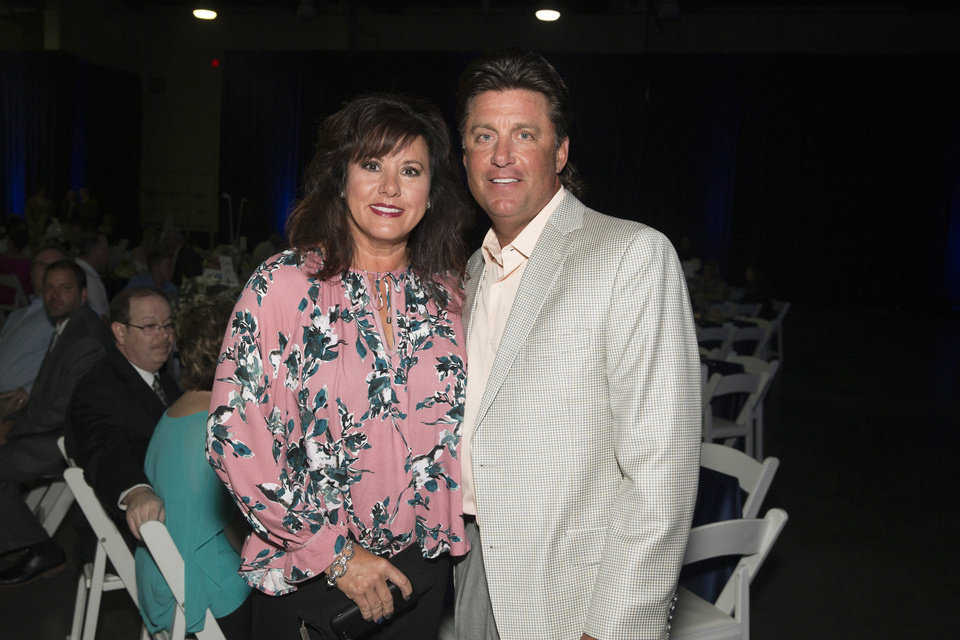 Photo - Kristen and Mike Gundy pose for a photograph during The Oklahoman's All-City Prep Sports Awards, celebrating top high school athletes, at the Cox Convention Center on Tuesday, June 26, 2018 in Oklahoma City, Okla.  Photo by Steve Sisney, The Oklahoman