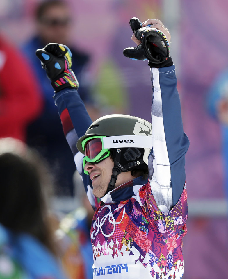 Photo - Russia's Vic Wild celebrates after winning the gold medal in the men's snowboard parallel giant slalom final at the Rosa Khutor Extreme Park, at the 2014 Winter Olympics, Wednesday, Feb. 19, 2014, in Krasnaya Polyana, Russia.(AP Photo/Andy Wong)