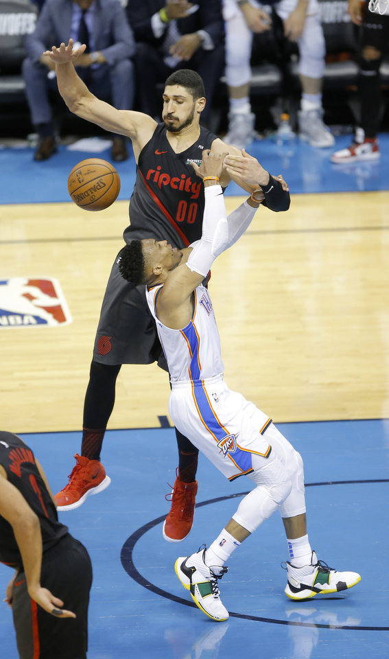 Photo - Oklahoma City's Russell Westbrook (0) loses the ball as Portland's Enes Kanter (00) defends during Game 4 in the first round of the NBA playoffs between the Portland Trail Blazers and the Oklahoma City Thunder at Chesapeake Energy Arena in Oklahoma City, Sunday, April 21, 2019. Portland won 11-98.  Photo by Bryan Terry, The Oklahoman