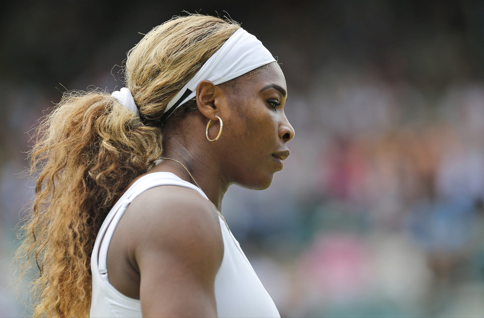 Photo - Serena Williams of the U.S. prepares to serve to Chanelle Scheepers of South Africa during their women's singles match at the All England Lawn Tennis Championships in Wimbledon, London, Thursday, June 26, 2014. (AP Photo/Ben Curtis)