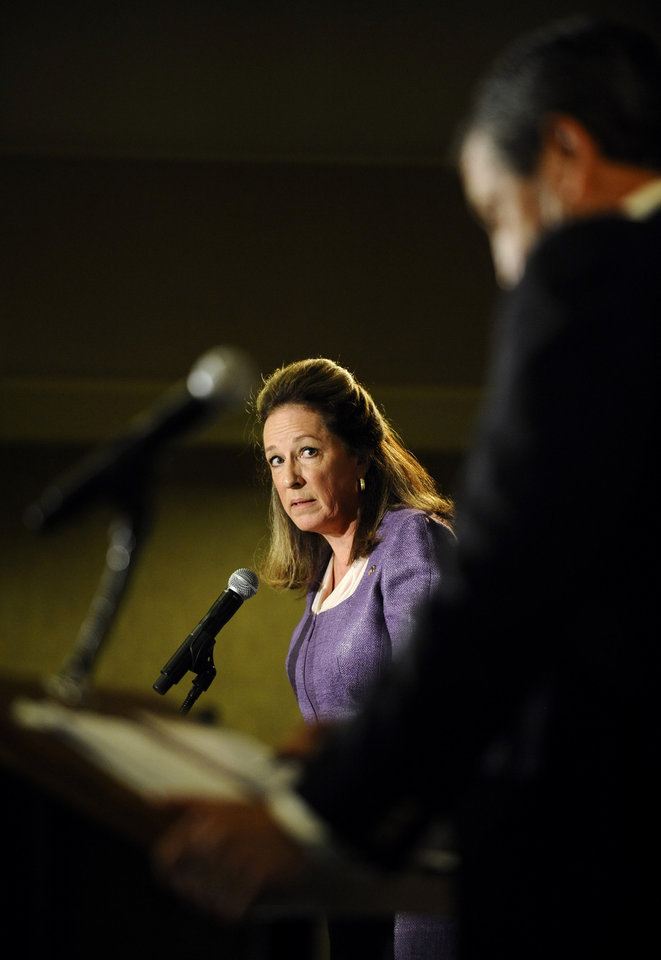 Democratic candidate Elizabeth Colbert Busch, left, looks at former South Carolina Gov. Mark Sanford as she answers a question during the 1st Congressional District debate on Monday, April 29, 2013 in Charleston S.C. (AP Photo/Rainier Ehrhardt)